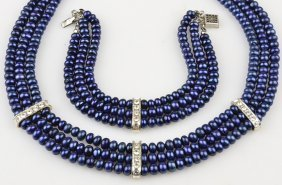 A DARK BLUE CULTURED PEARL NECKLACE AND BRACELET SET Go