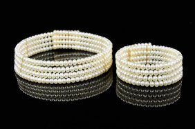 A FOUR STRAND WHITE CULTURED PEARL CHOKER NECKLACE AND