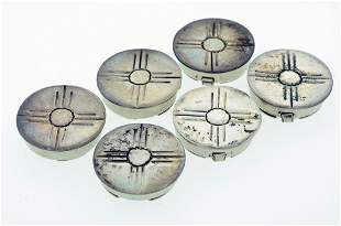 A SET OF SIX SILVER BUTTON CASES Good condition.