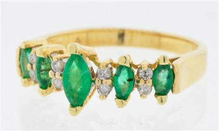 A LADY'S 14 KT YELLOW GOLD EMERALD AND DIAMOND RING Goo