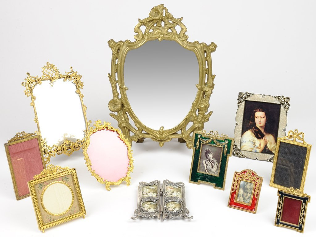 A GROUP OF ART NOUVEAU AND ROCOCO STYLE MIRRORS WITH GI