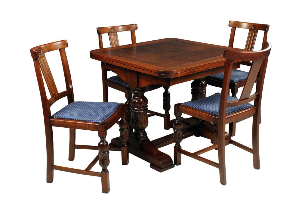 AN ANTIQUE JACOBEAN STYLE BREAKFAST TABLE AND FOUR CHAI