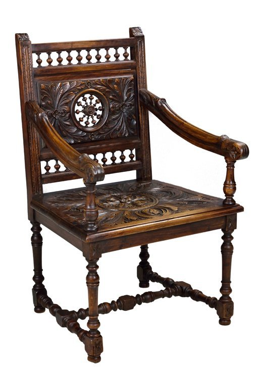 AN ANTIQUE HAND CARVED LOUIS XIII STYLE OAK ARMCHAIR
