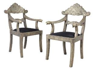 A PAIR OF ANTIQUE INDIAN SILVER METAL REPOUSSE ARMCHAIR