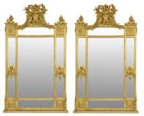 A DRAMATIC PAIR OF FRENCH LOUIS XVI STYLE GILTWOOD MIRR