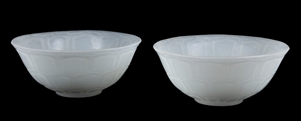 A PAIR OF CARVED WHITE PEKING GLASS BOWLS Early 20th Ce