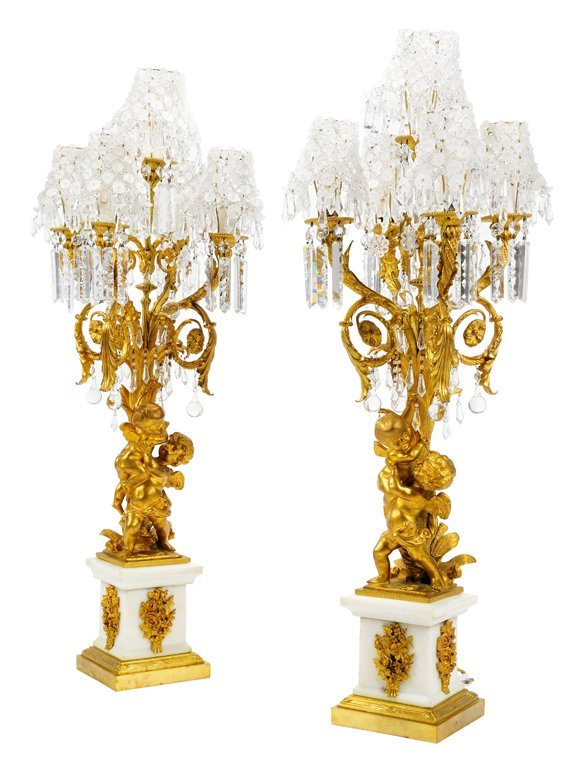 A PAIR OF LOUIS XVI STYLE BRONZE DORE AND CRYSTAL FIVE-
