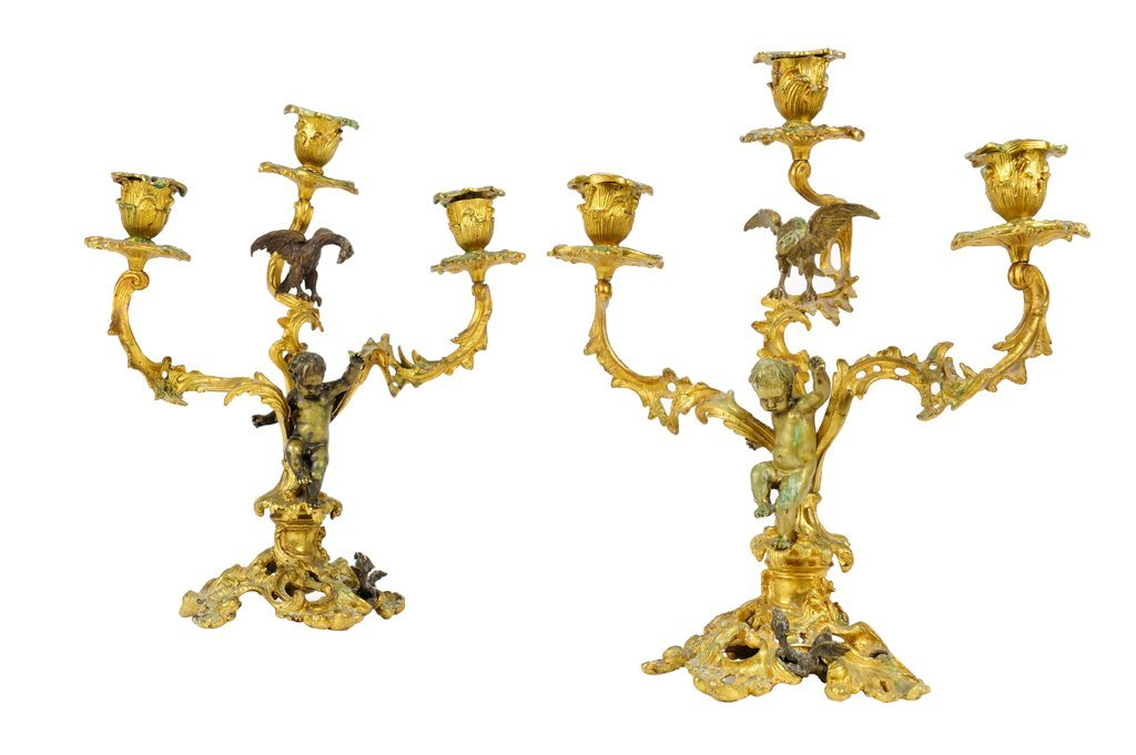 A PAIR OF BRONZE DORE AND PATINATED BRONZE THREE-LIGHT