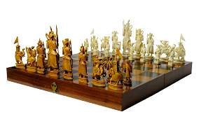 A LARGE MASTERFULLY CARVED ASIAN IVORY 32 PIECE CHESS S