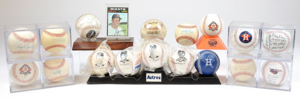 A COLLECTION OF SIGNED BASEBALLS INCLUDING A ROGER CLEM