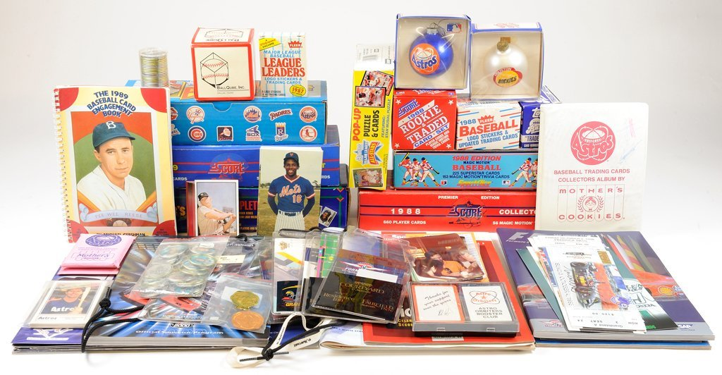 A COLLECTION OF BASEBALL CARDS AND BASKETBALL AND NASCA
