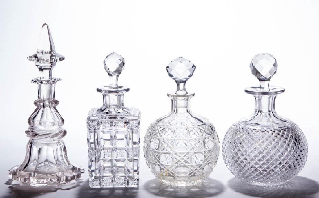 ASSORTED CUT GLASS COLOGNE BOTTLES, LOT OF FOUR
