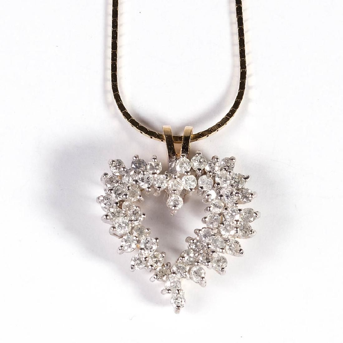 VINTAGE LADY'S 14K GOLD AND DIAMOND FIGURAL PENDANT