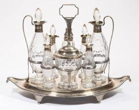ENGLISH CUT GLASS AND STERLING SILVER EIGHT-BOTTLE