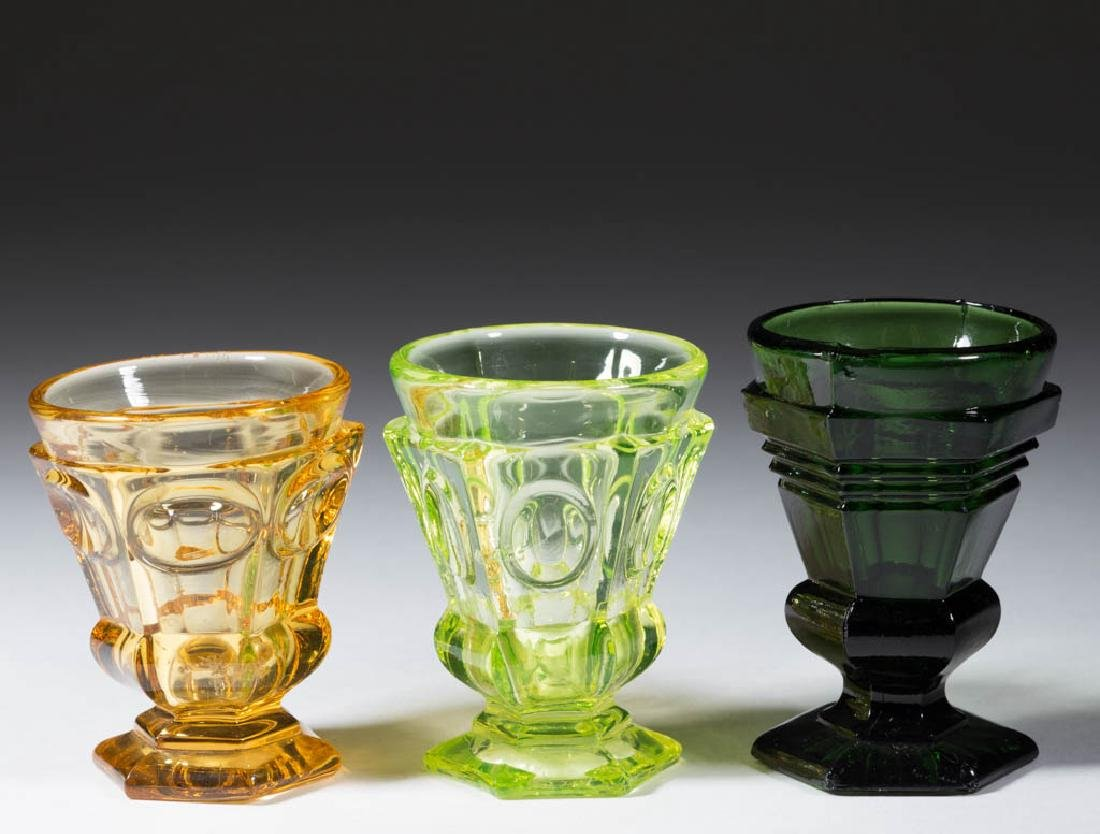 ASSORTED PRESSED TOY SPOON HOLDERS / FOOTED TUMBLERS,