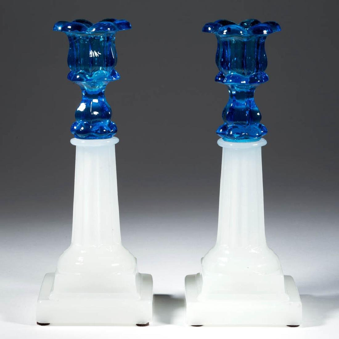 PRESSED PETAL AND COLUMNAR PAIR OF CANDLESTICKS