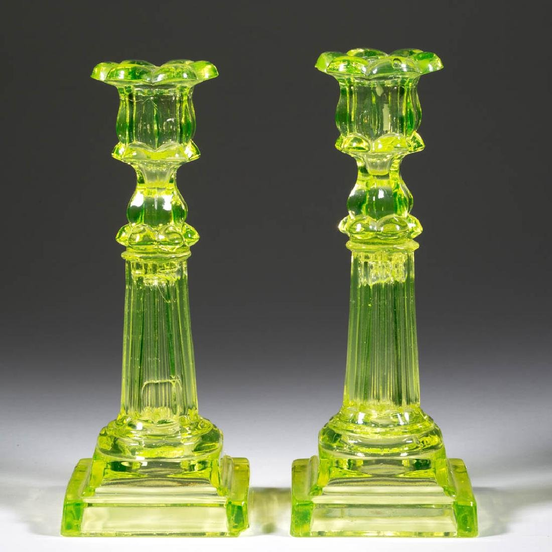 PRESSED PETAL AND COLUMNAR NEAR PAIR OF CANDLESTICKS