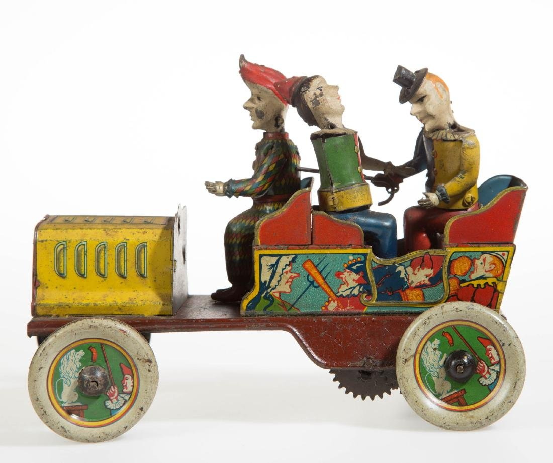 HANS EBERL TIN TOY WIND-UP CLOWN CAR