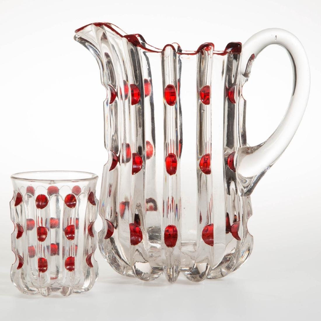 BROKEN COLUMN - RUBY-STAINED WATER PITCHER AND TUMBLER