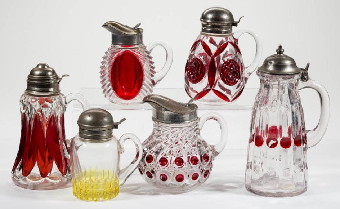 ASSORTED RUBY-STAINED GLASS SYRUP PITCHERS, LOT OF SIX