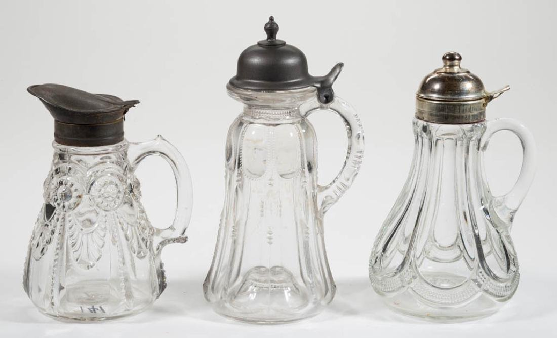 ASSORTED EAPG SYRUP PITCHERS, LOT OF THREE