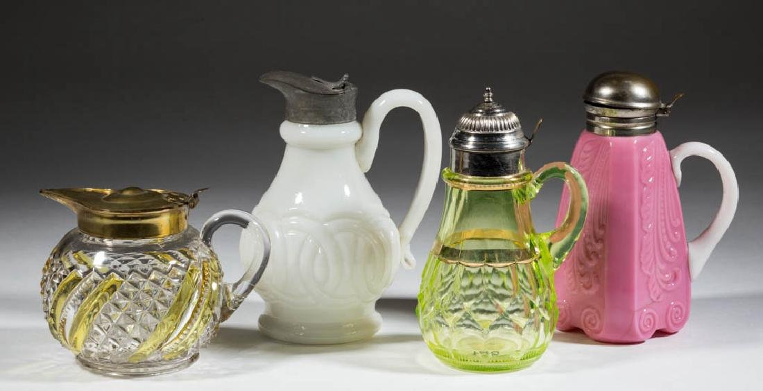 ASSORTED GLASS SYRUP PITCHERS, LOT OF FOUR