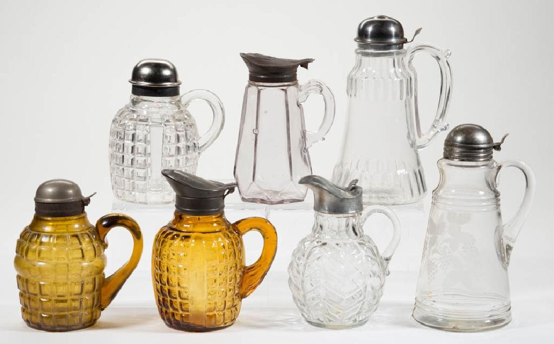 ASSORTED PRESSED GLASS SYRUP PITCHERS, LOT OF SEVEN
