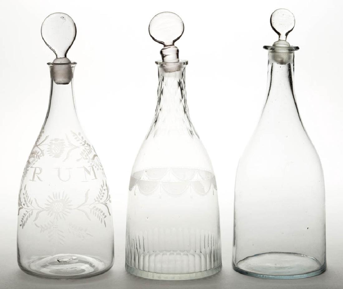 ASSORTED FREE-BLOWN QUART DECANTERS, LOT OF THREE