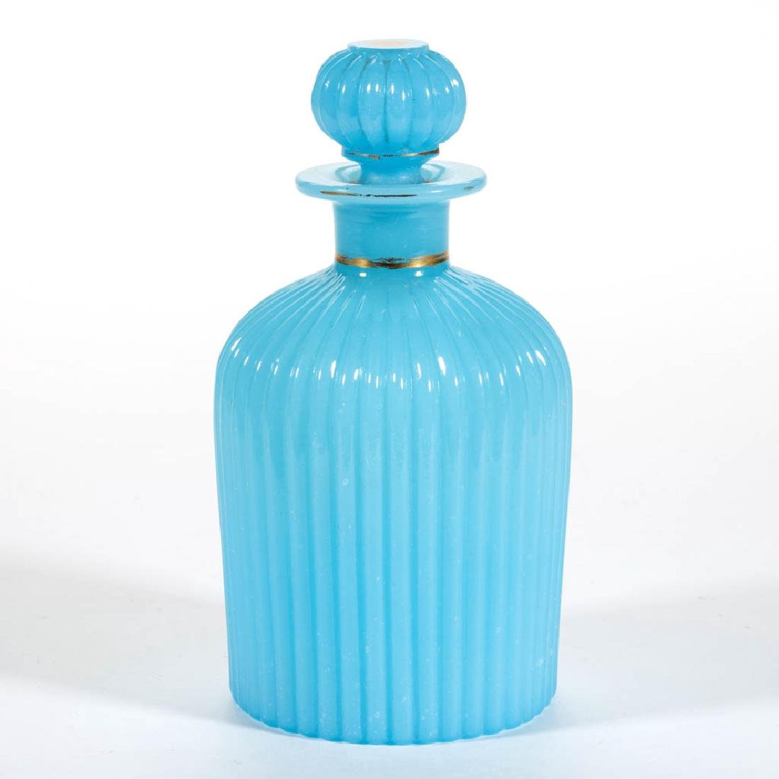 BLOWN-MOLDED RIBBED COLOGNE BOTTLE