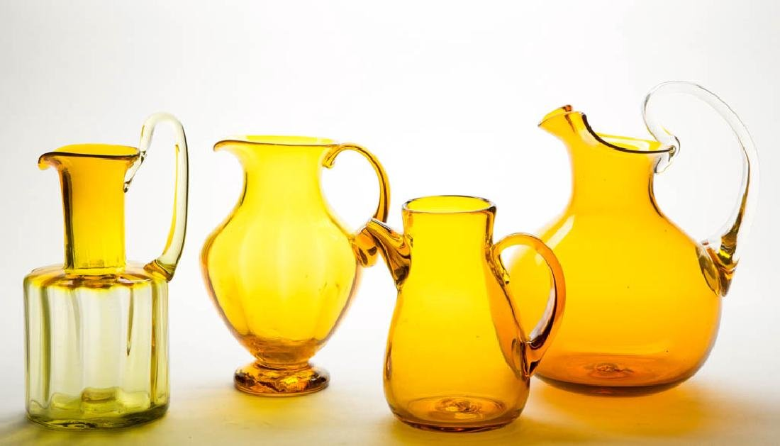 BLENKO JONQUIL AND AMBER GLASS PITCHERS, LOT OF FOUR