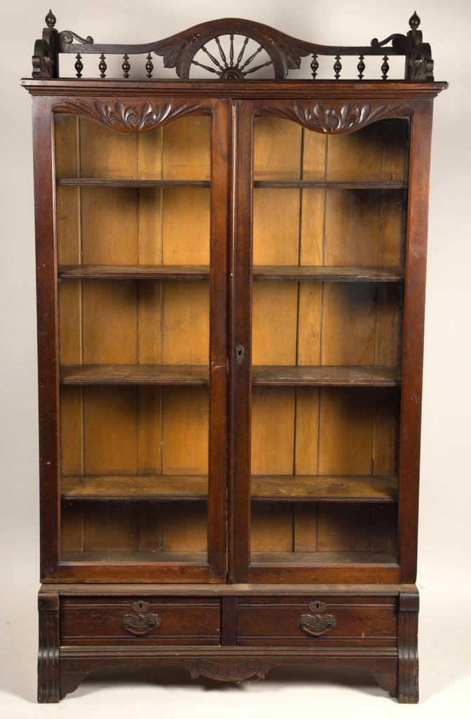 AMERICAN VICTORIAN CARVED WALNUT BOOKCASE