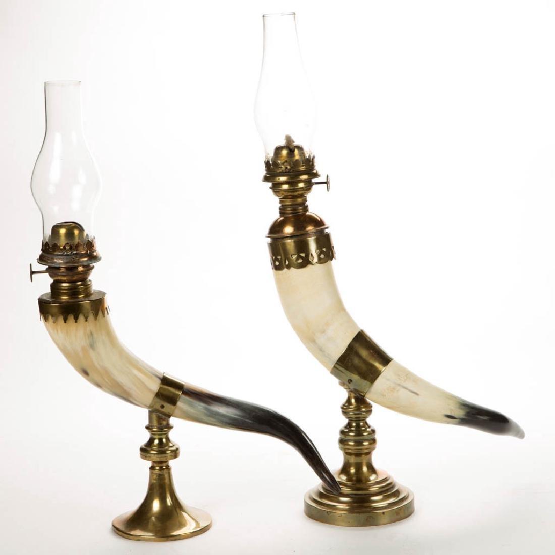BRASS AND POWDER HORN KEROSENE LAMPS, LOT OF TWO