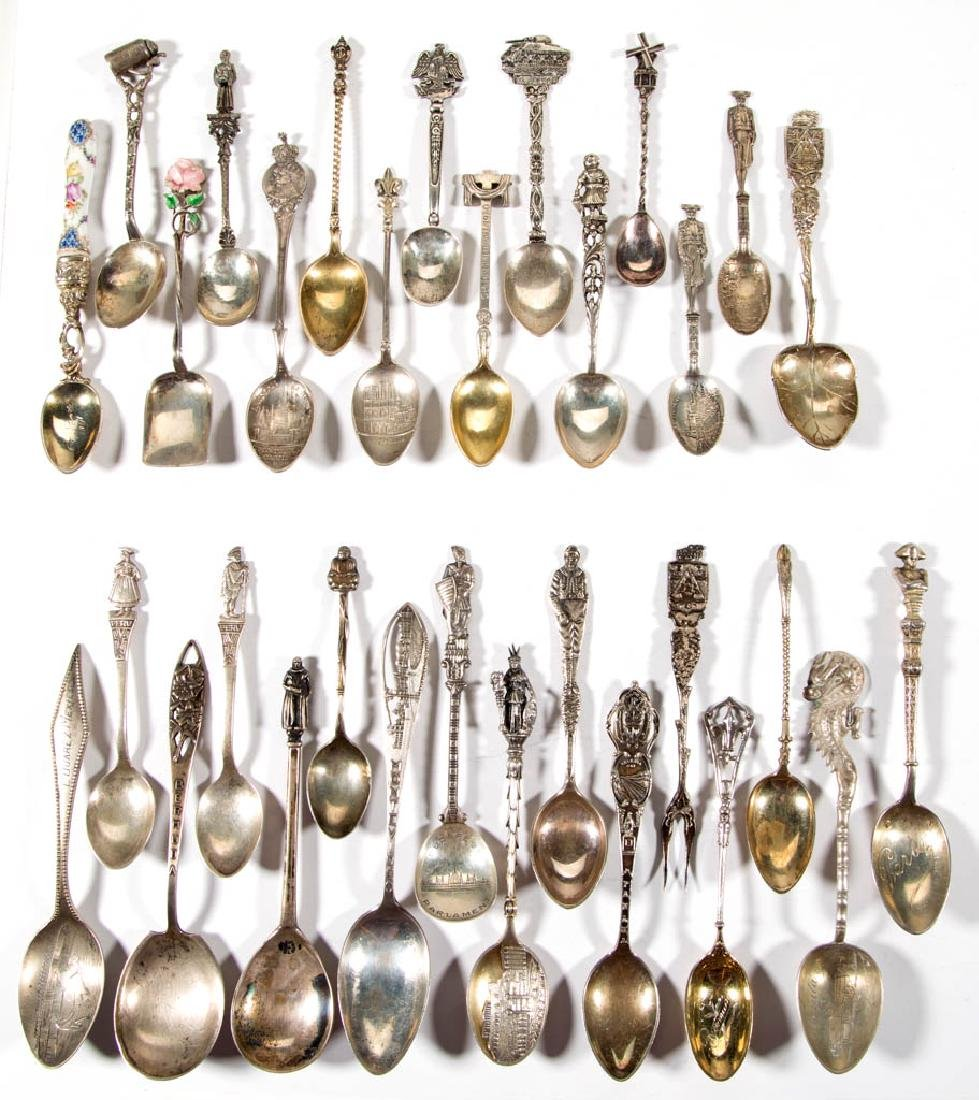 ASSORTED FOREIGN FIGURAL SILVER SOUVENIR SPOONS AND ONE