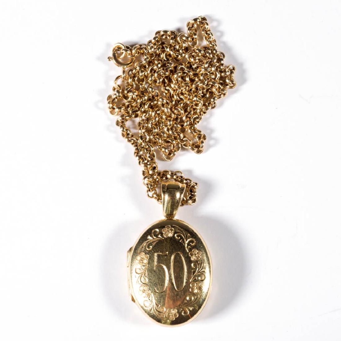 VINTAGE 18K GOLD LOCKET AND 14K GOLD CHAIN