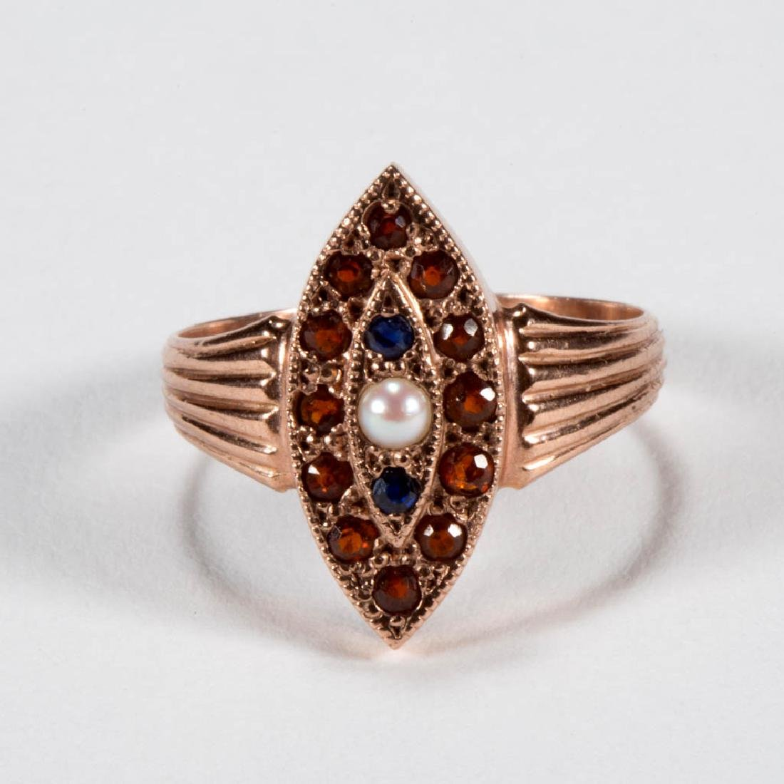 EDWARDIAN 9K GOLD AND SPESSARTITE GARNET LADY'S RING