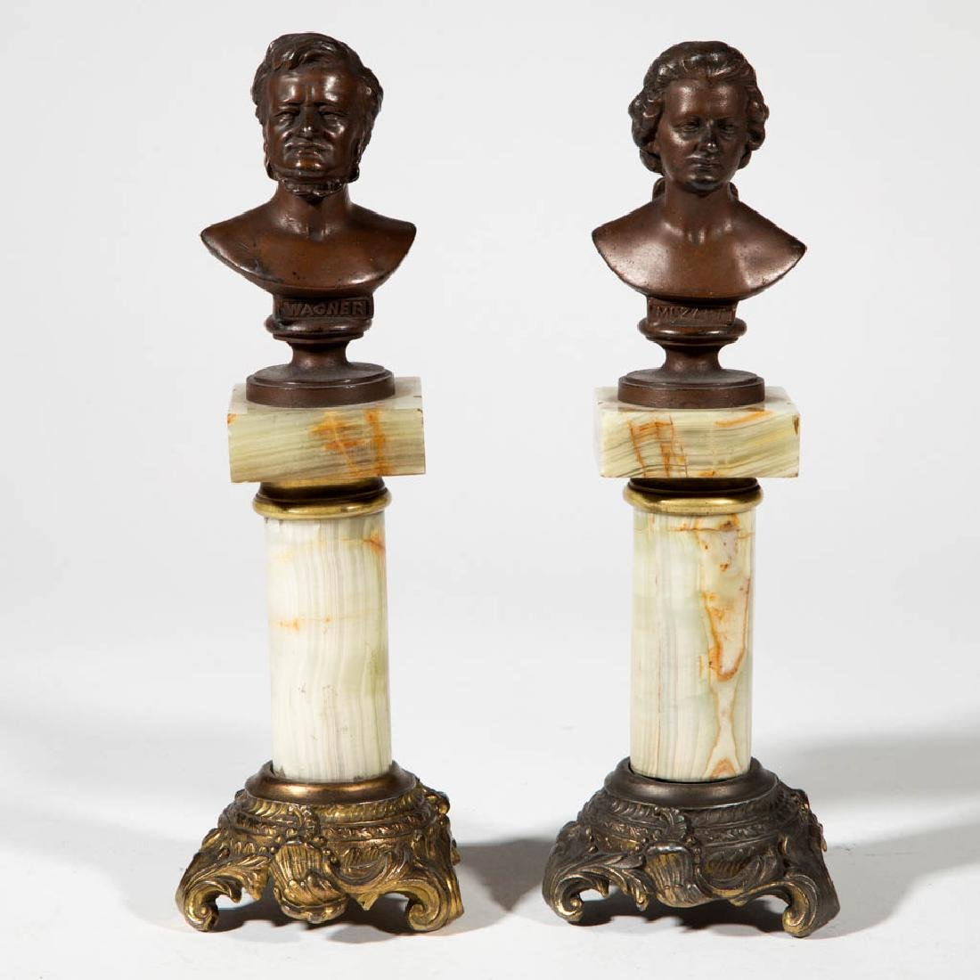 PAIR OF CONTINENTAL GRAND TOUR BUSTS ON ONYX PEDESTALS