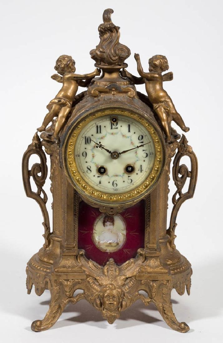 FIGURAL CAST-METAL MANTLE CLOCK