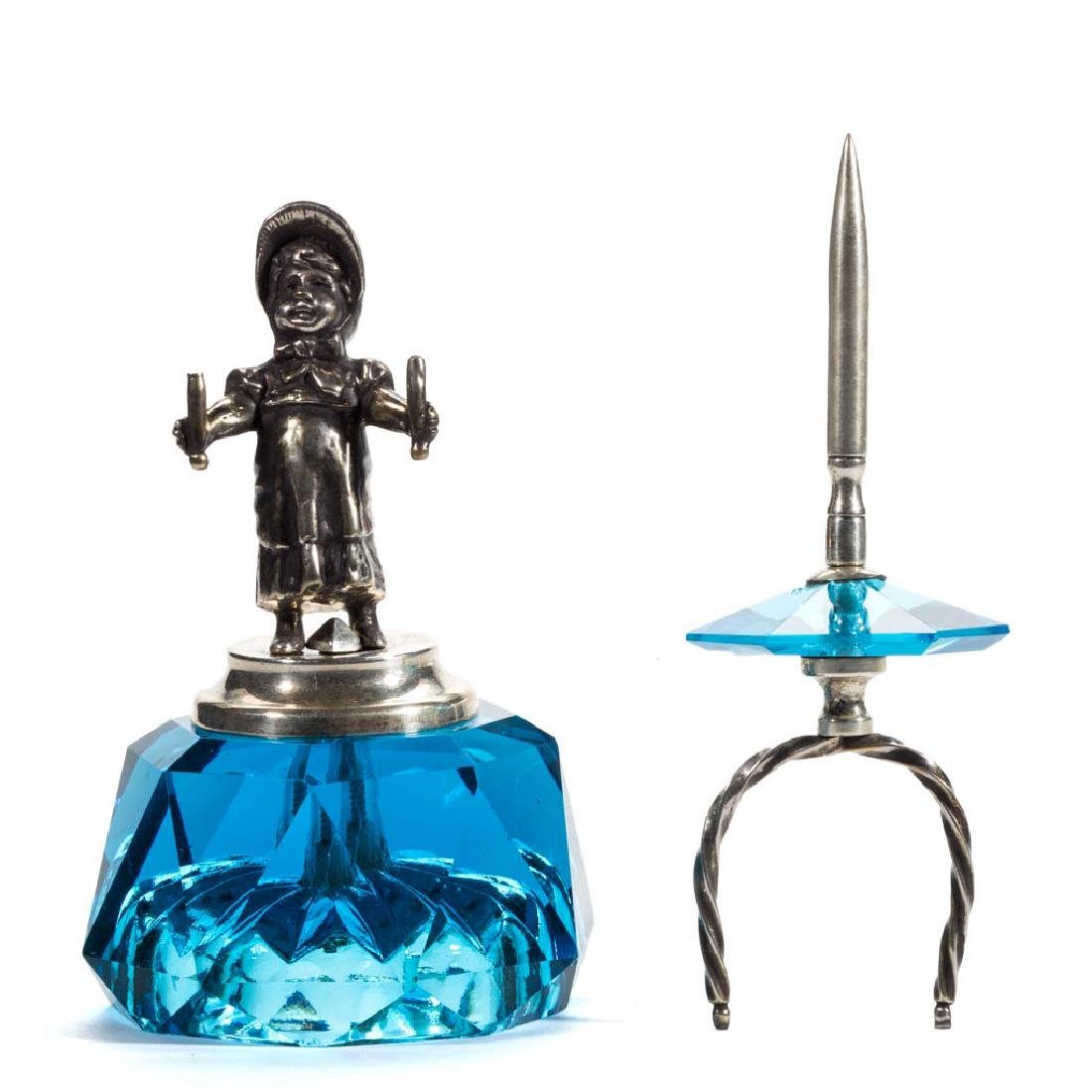 KATE GREENAWAY FIGURAL SILVER-PLATED AND GLASS SPINDLE