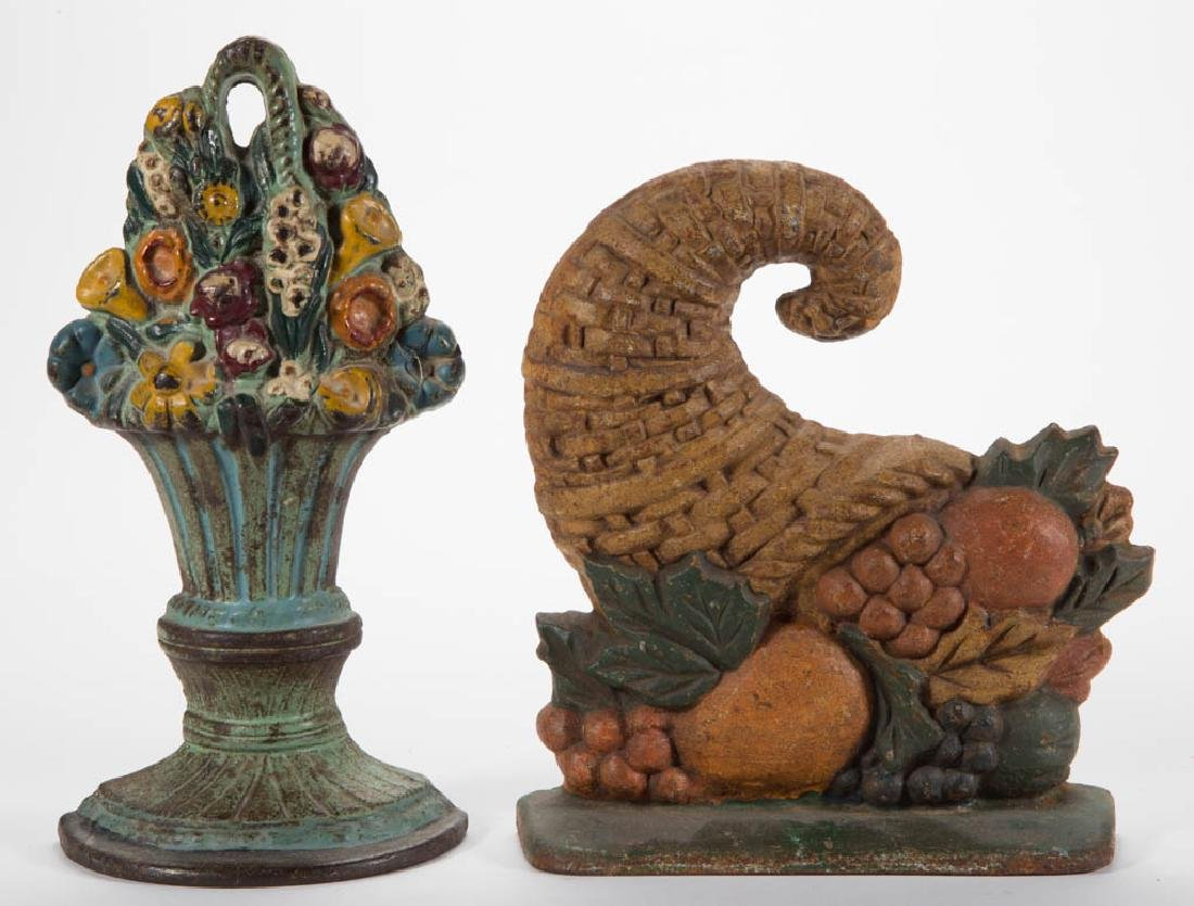 CAST-IRON FLORAL DOORSTOPS, LOT OF TWO