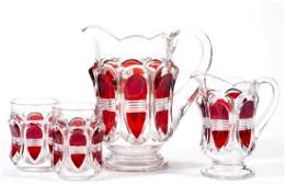 BARRED OVAL - RUBY-STAINED THREE-PIECE WATER SET
