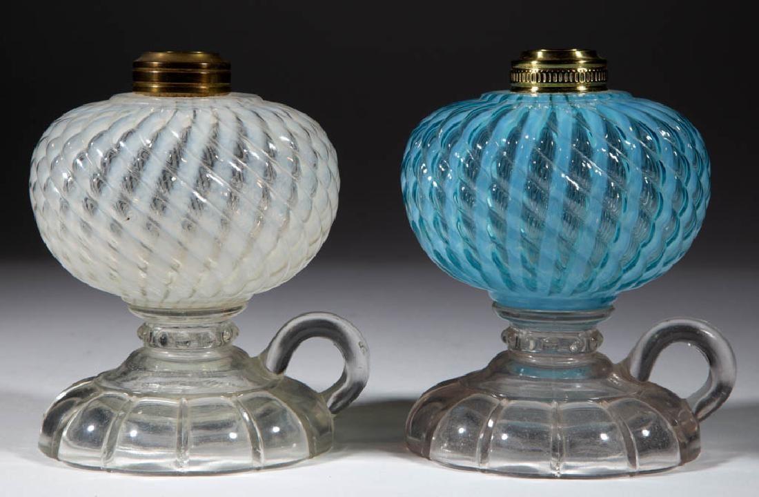 SHELDON SWIRL KEROSENE FOOTED FINGER LAMPS, LOT OF TWO