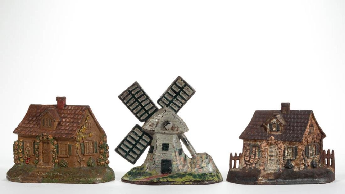 CAST-IRON FIGURAL WINDMILL AND COTTAGE DOORSTOPS, LOT