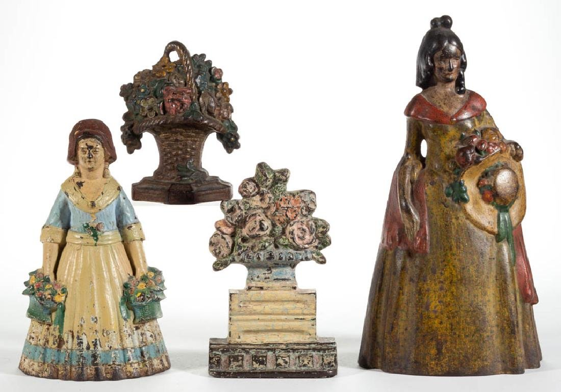 CAST-IRON FIGURAL LADY AND FLOWER DOORSTOPS, LOT OF