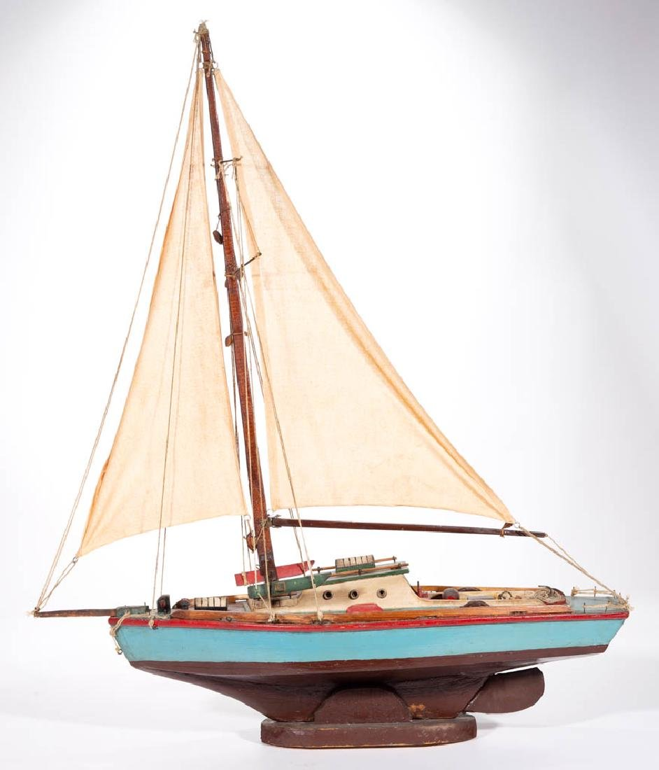 FOLK ART CARVED AND PAINTED POND SAILBOAT