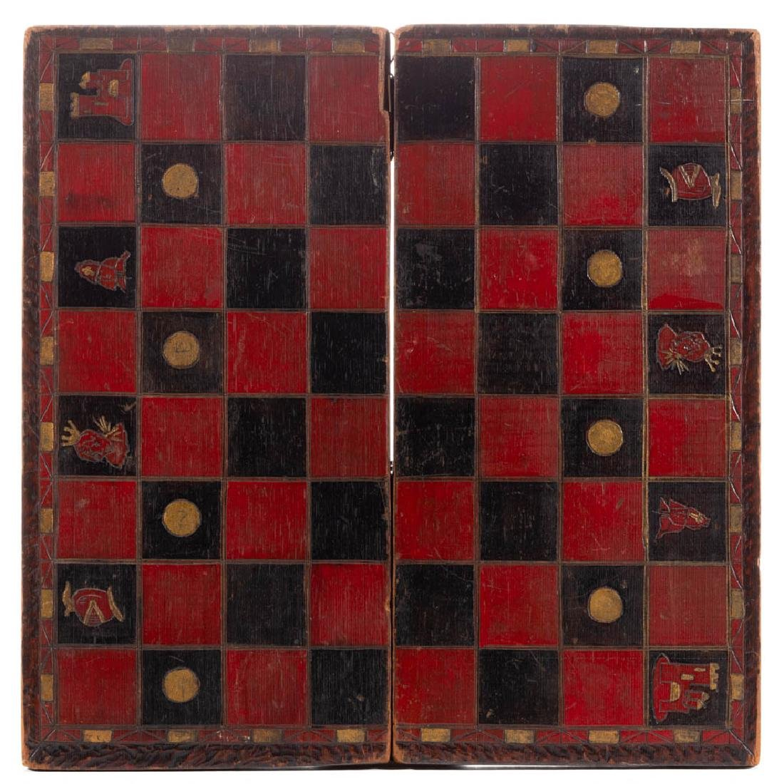 FOLK ART CARVED AND PAINTED WALNUT GAMEBOARD