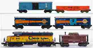 LIONEL O-GAUGE LOCOMOTIVE AND FREIGHT CARS, LOT OF 12