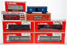 LIONEL O-GAUGE ERIE LOCOMOTIVE AND CARS, LOT OF NINE