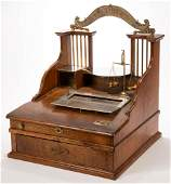 ANTIQUE OAK AND BRASS GOLD SCALE REGISTER