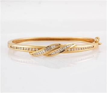 VINTAGE 14K YELLOW GOLD AND DIAMOND BANGLE BRACELET