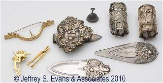581: NINE ASSORTED METALS LADY'S ACCOUTREMENTS